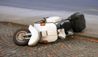 motor scooter hit by car